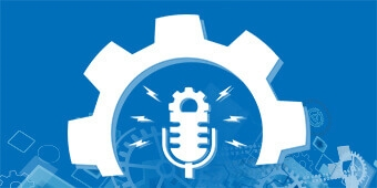 An industrial cog with a podcast microphone sitting inside it